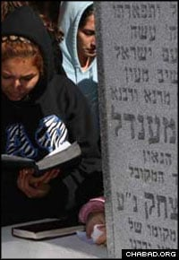 College students reflect and pray to G-d at the Rebbe's resting place in Cambria Heights, N.Y. (Photo: Y. Taichman)