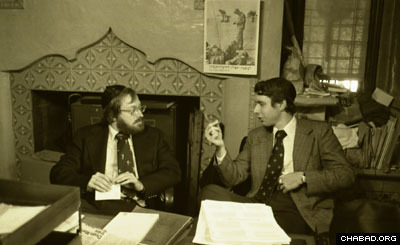 Two doctors discuss the Rebbe's health situation in a makeshift doctor's office in Lubavitch World Headquarters (Photo: Levi Freidin courtesy of JEM)