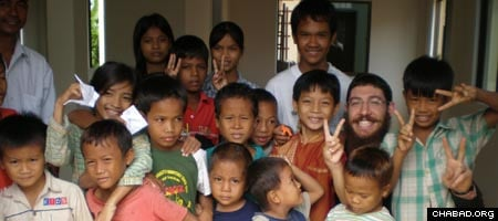 Rabbi Saadya Notik, second from right, and other rabbinical students visited a newly-built orphanage during their time in Cambodia in 2007.