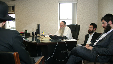 Rabbi Moshe Kotlarsky, aided by his son, Rabbi Mendy, and Rabbi Schneor Nejar prepares rovers for their summer's work.