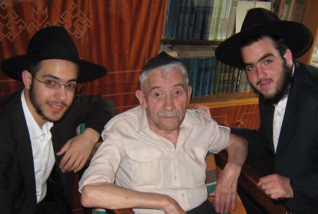 With Uncle Fima who speaks Yiddish.