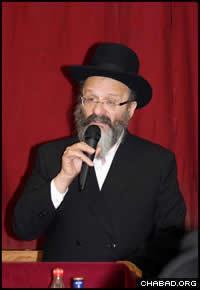 Rabbi Nachman Holtzberg addresses a Chasidic gathering at Lubavitch House in Stamford Hill, London.