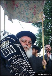 Celebrants paraded the new Torah scroll beneath the same canopy that Rabbi Aharon Mendel Hazan let Russian immigrants to Israel use for their weddings.