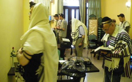 Rabbi Hartman leads morning prayers at the Chabad House in Ho Chi Minh City.