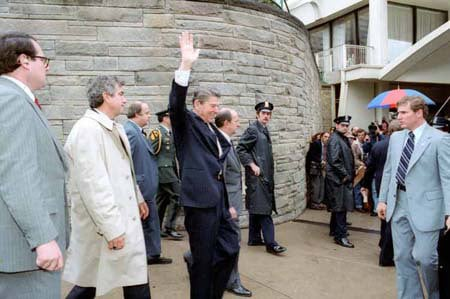 President Reagan waves to crowd, as he leaves the Hilton Hotel, immediately before being shot in an assassination attempt. (The Reagan Library)