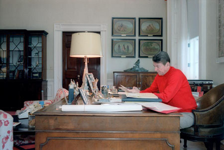 President Reagan working in his residence study on April 15th, the day he wrote the letter to the Rebbe. (The Reagan Library)