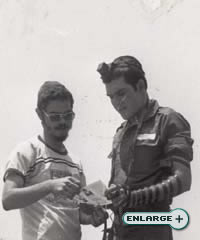 A Lubavitcher dons Tefillin with an Israeli soldier
