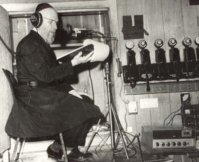 Rabbi J.J. Hecht in the recording room during his weekly radio show, which commenced in the early 1950s
