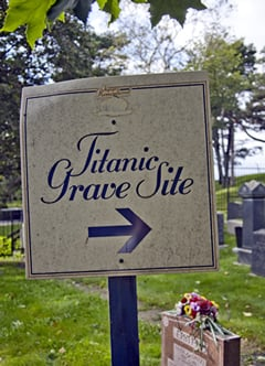 A simple sign points the way to the small section of a Jewish cemetery where victims of the Titanic are buried.