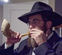 Rabbi Mendel Feldman sounds the shofar.