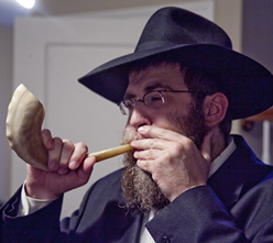 Rabbi Mendel Feldman sounds the shofar.