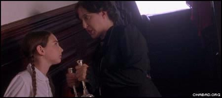 """Played by Judy Winegard, right, Miss Agatha Grimshaw takes away Shabbat candles belonging to Miriam Aronowitch, played by Abby Shapiro in """"A Light for Greytowers."""""""