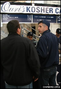 Patrons place their orders at one of five kosher concession stands at Yankee Stadium.Credit: Yossi Percia