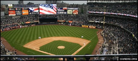 Thousands of fans stand for the National Anthem before Game 2 of the World Series at Yankee Stadium in the Bronx, N.Y. Credit: Yossi Percia