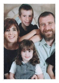 Three-year-old Alta Shula Swerdlov, A''H, pictured here with her parents, Rabbi Yossi and Hinda Swerdlov, and an older brother.