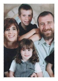 "Three-year-old Alta Shula Swerdlov, A""H, pictured here with her parents, Rabbi Yossi and Hinda Swerdlov, and an older brother."