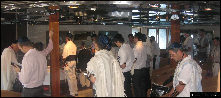 Family and friends of bar mitzvah boy Douglas Mishaan participate in a prayer service aboard the Sea Dream II in the Caribbean Sea.