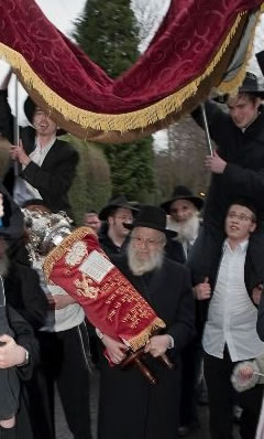 Dancing with the Torah in Manchester.