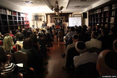 Attendees screen a video produced by Jewish Educational Media describing the dedication of the Holtzbers and the day-to-day life at the Mumbai Chabad House. (Photo: David Levi)