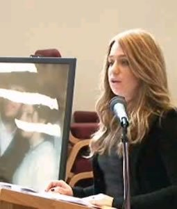 Rikal Kaler addresses a memorial gathering for her brother and sister-in-law in Pikesville, Maryland.