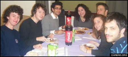 American Jewish students in Edinburgh, Scotland, enjoy a kosher Thanksgiving-themed meal at their local Chabad House.