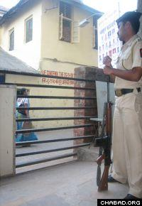 An Indian officer stands guard outside Mumbai's Nariman House.