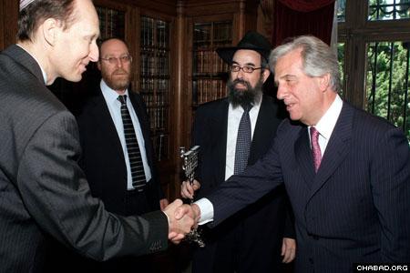 Uruguayan Jewish community leaders Nestor Sztryck, left, Daniel Ascher and Chabad-Lubavitch Rabbi Eliezer Shemtov greeted outgoing President Dr. Tabare Vazquez. (Photo: Magela Ferreo)