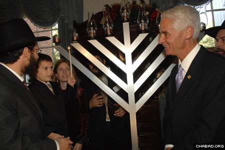 Florida Gov. Charlie Crist joins the Chanukah menorah lighting at the Governor's Mansion on the first night of the eight-day holiday.