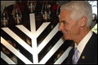 Florida Governor Assists Six Year Old During Menorah Lighting