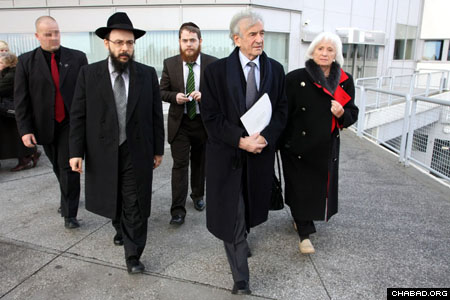 """Chabad-Lubavitch Rabbis Baruch Oberlander, left, and Shlomo Koves escort Elie and Marion Wiesel to the Hungarian Parliament for the Dec. 9 legislative conference on """"Jewish-Hungarian Solidarity for a Shared Future."""""""