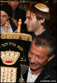 The brothers joined community members in Gothenburg, Sweden, for rounds of dancing with the Torah scroll.