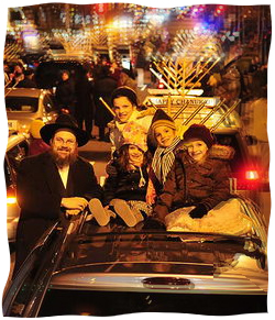 The author's husband and children at the Menorah Parade in Philadelphia. Photo by Baruch Ezagui.