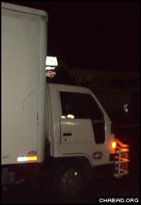 A truck stocked with supplies departs Chabad-Lubavitch of the Dominican Republic for Port-au-Prince, Haiti.