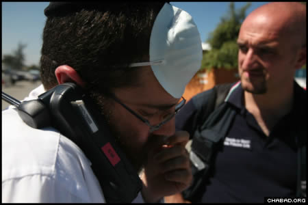 Chabad-Lubavitch Rabbi Shimon Pelman, director of Chabad-Lubavitch of the Dominican Republic, travelled to neighboring Haiti on Friday to assess the needs of locals and emergency personnel in the devastated capital of Port-au-Prince. (Photo: Marc Asnin/Chabad.org)