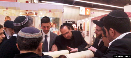 Jewish visitors and exhibitors take part in a Torah reading at the Spielwarenmesse International Toy Fair in Nuremberg, Germany.