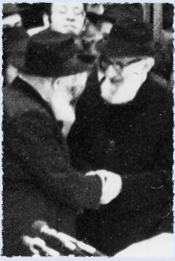 Rabbi Joseph B. Soloveitchik is greeted by the Rebbe at a chassidic gathering in Lubavitch World Headquarters.