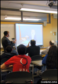 "Rabbi Avraham Kivelevitz uses ""Kabbala Toons"" episodes to teach some 30 teenage boys and girls at SAR High School in Riverdale, N.Y."