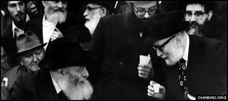 Rabbi Yosef Wineberg, right, receives a blessing from the Rebbe, Rabbi Menachem M. Schneerson, of righteous memory, who personally edited his radio lectures for 20 years.
