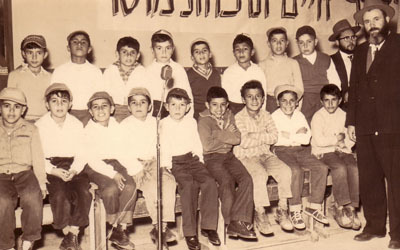 Rabbi Binyomin Levin, extreme right, with the choir that the Rebbe, Rabbi Menachem Mendel Schneerson, of righteous memory, instructed him to organize.
