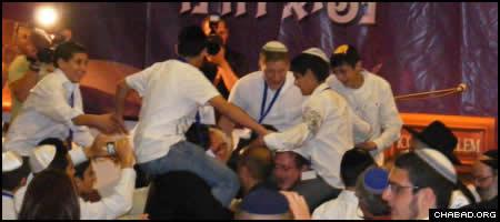 Israeli orphans celebrate after their mass Bar Mitzvah ceremony at Jerusalem's Western Wall.