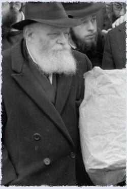 The Rebbe waits for the old car to be brought back.