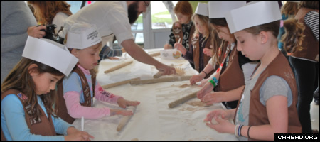 A troop of Jewish Girl Scouts take part in a model matzah bakery hosted by the Dallas Jewish Community Center and run by Chabad-Lubavitch of Dallas.
