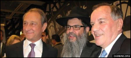 Paris Mayor Bertrand Delanoe, left, Chabad-Lubavitch Rabbi Meir Chai Benhiyoun, and Chicago Mayor Richard M. Daley, pose for a picture during a private reception at the Chicago French Market April 27.