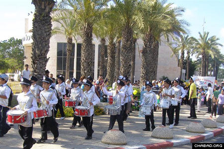As in cities throughout Israel, a children's drum corps led celebrants through the coastal city of Ashkelon.