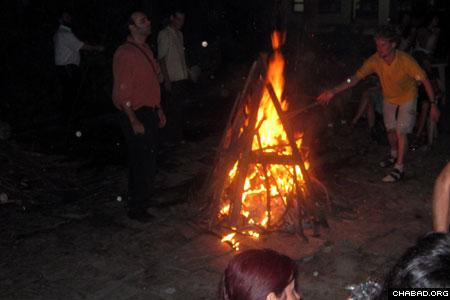 Echoing similar celebrations around the world, Kathmandu's Saturday night bash featured a large bonfire.