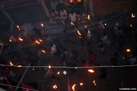 In Kathmandu, Nepal, where opposition forces closed the streets, local Jews and Israeli backpackers marched around the Chabad House with torches in a makeshift nighttime parade.