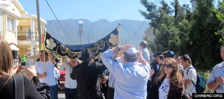 Jewish celebrants parade Chabad Lubavitch of North Cyprus' first Torah scroll down the streets of Kyrenia.
