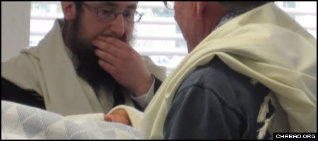 Rabbi Yossi Hecht, left, and his infant son at Ocala, Fla.'s first-recorded traditional Jewish circumcision.