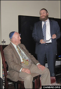 Rabbi Chaim Lazeroff, right, invited Spritzer to address the group.