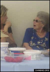 Community members enjoy the celebratory meal after Menachem Mendel Hecht's circumcision.